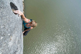 Climber is sending on rock over Missouri waters